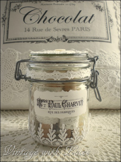 Altered jar with lace and French label