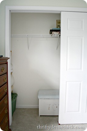 organized bedroom closet with shelves on side