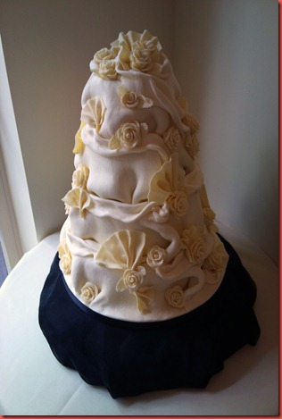 4 tier chocolate ruffle and rose and fans cake