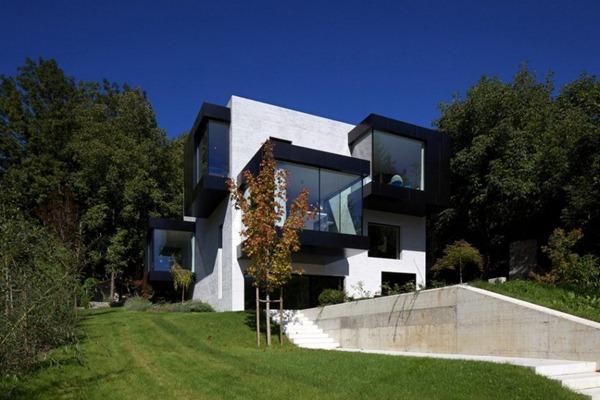 Fachadas cubicas y modernas por bergmeisterwolf architects for Fachadas de casas modernas en italia