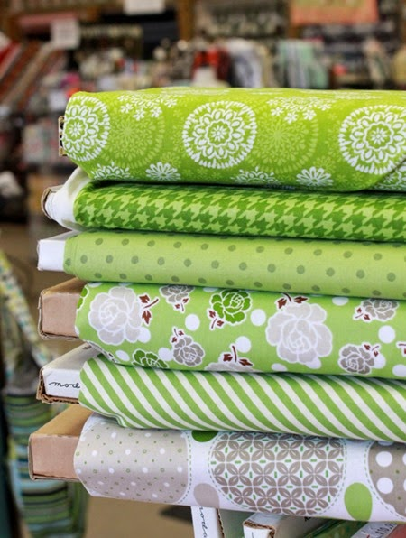 stack of green fabrics