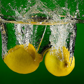 Lemon Drops by Troy Wheatley - Food & Drink Fruits & Vegetables ( water, fruit, lemons, splash, wet,  )