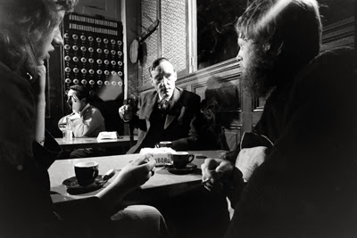 William S. Burroughs with unidentified companions in a Paris cafe, 1959-