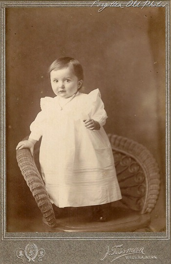 Child standing in chair