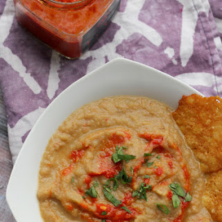 Roasted Eggplant Bisque with Harissa and Parmesan Crisps.
