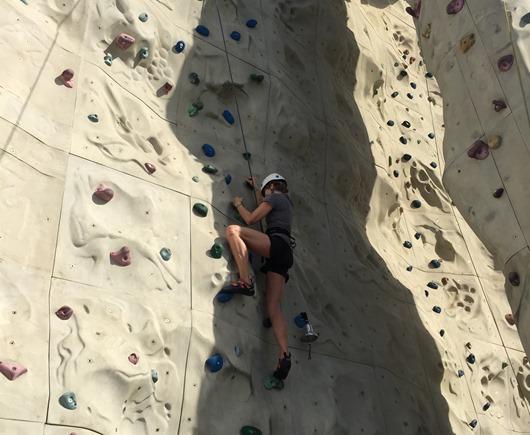 Climbing rock wall on a cruise