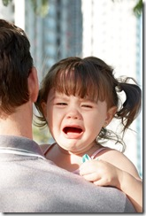 crying on father's shoulder