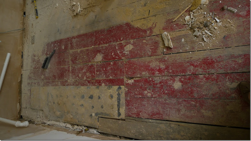 9 found 1800s red floorboards under kitchen