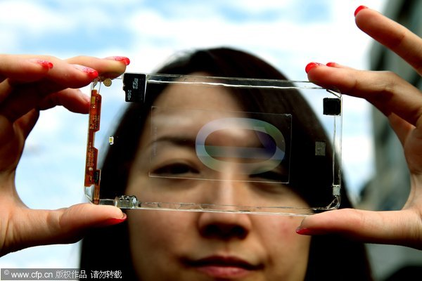 epa03547991 Serena Chen, Deputy Manager of Polytron technologies, Inc. displays the prototype of a transparent cellphone in Taoyuan City, northern Taiwan, 21 January 2013. Polytron are reportedly hoping that the phone will be on the market by the end of 2013.  EPA/DAVID CHANG