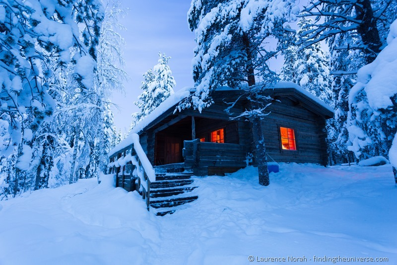 cabin woods snow blue hour