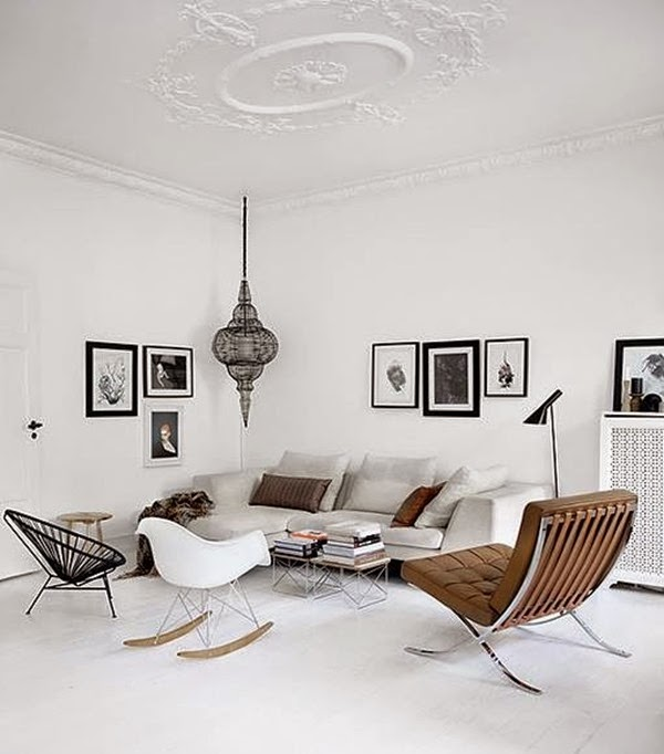 white-rug-white-rocking-chair-black-cool-chair-brown-comfy-chair-small-table-books-bar-stool-grey-sofa-with-cushions-pendant-lamp-paintings-on-the-wall-floor-lamp
