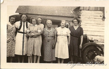 Ladies lined up Car may be a Dodge Tin Ceiling