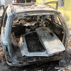 Un véhicule incendié au siège inter fédéral du PPRD le 5/9/2011 à Kinshasa. Radio Okapi/ Ph. John Bompengo