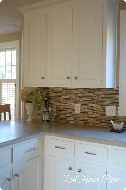 white kitchen natural backsplash
