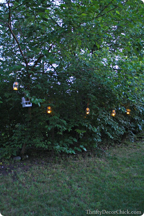 mason jar lanterns in trees