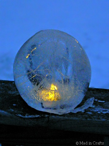lit clear ice lantern