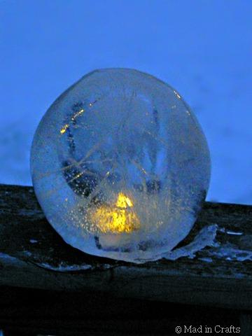 lit clear ice lantern