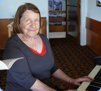 Helen Smith with her debut at the Club on the Clavinova. Photo courtesy of Dennis Lyons.