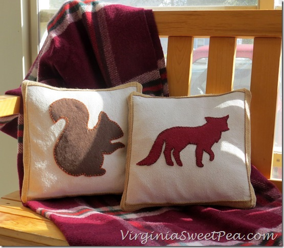 Squirrel and Fox Pillows on Porch