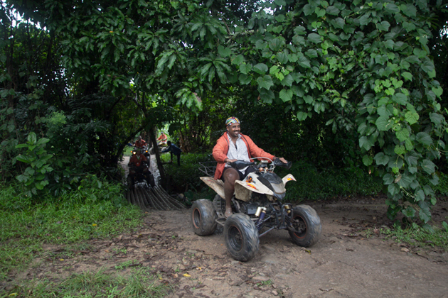 All terrain vehicle rides through dense forests