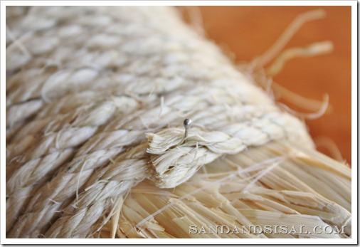 Pin rope onto straw wreath