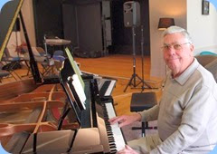 Jim Nicholson playing the grand piano. Photo courtesy of Dennis Lyons.