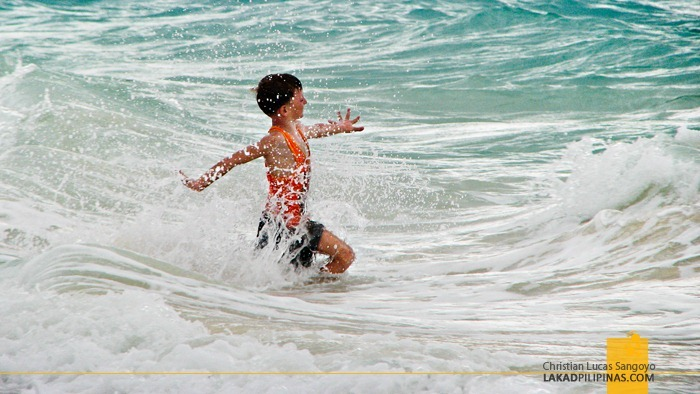 A Kid Playing Along Boracay's Strong Waves