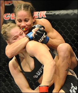 Feb 23, 2013; Anaheim, CA, USA;    Ronda Rousey and Liz Carmouche during their UFC women's world bantamweight championship bout at the Honda Center. Mandatory Credit: Jayne Kamin-Oncea-USA TODAY Sports