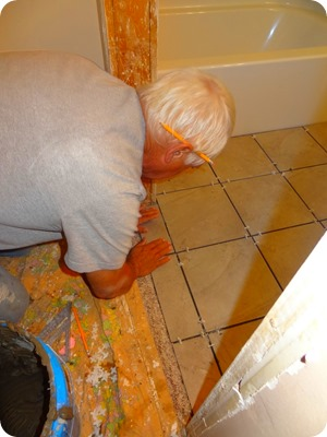 paul laying tile