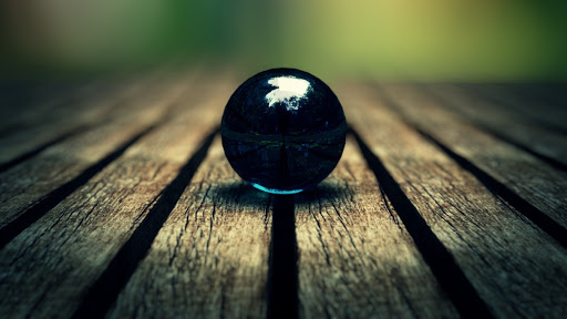 Abstract Blue Ball on Wood