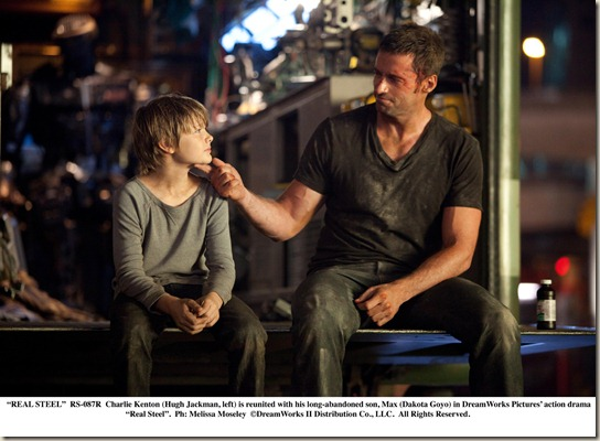 """REAL STEEL""..RS-087R..Charlie Kenton (Hugh Jackman, left) is reunited with his long-abandoned son, Max (Dakota Goyo) in DreamWorks Pictures' action drama ""Real Steel""...Ph: Melissa Moseley..©DreamWorks II Distribution Co., LLC. ÊAll Rights Reserved."