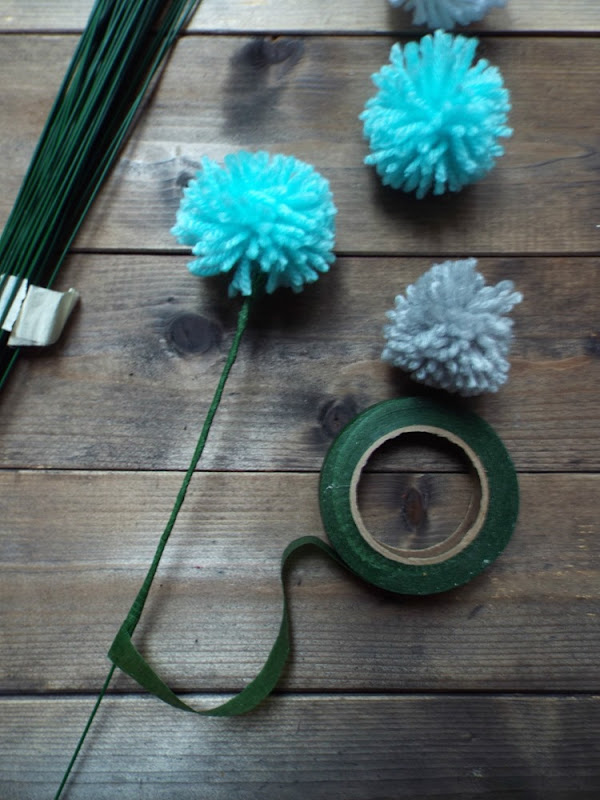 diy pompom bloom wrapping the stem