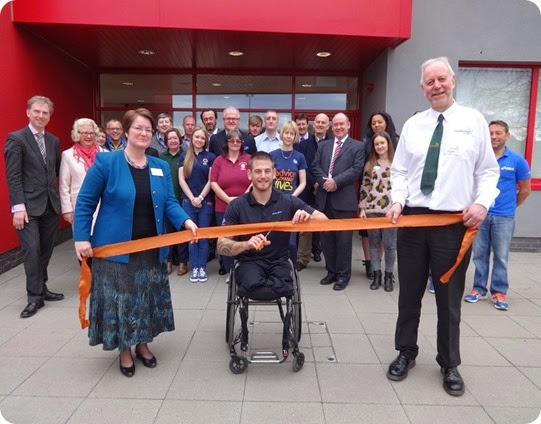 Joe Townsend cuts the ribbon outside the centre in front of dignitaries and guests