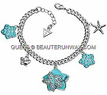 GUESSSpring Summer 2012 Jewellery Ocean Glam collection starfish, statement oversized bib necklace, cuff bracelets, earrings and ringsbwith turquoise enamel aqua genuine crystal accents