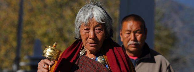 Elderly Woman offering prayers at Memorial Chorten, Thimphu, Bhutan