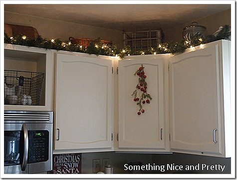 garland for above kitchen cabinets our home tour 15772
