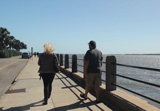 Ally and Jim walking along the Battery in Charleston