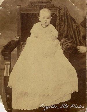 Baby in long gown  DL Antiques