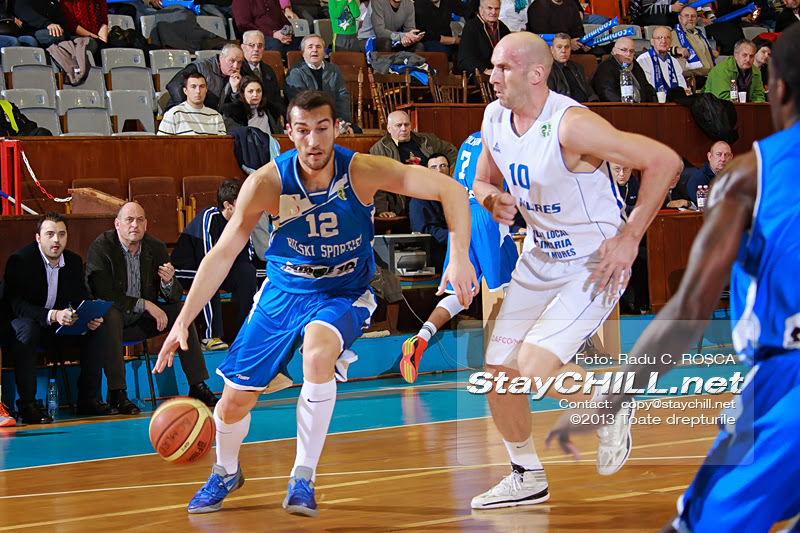 Zlatin Georgiev drives the ball against Ivan Ivanovic in the FIBA EuroChallenge game between BC Mures from Romania and Rilski Sportist from Bulgaria played at City Arena in Tirgu Mures on December 17th, 2013.