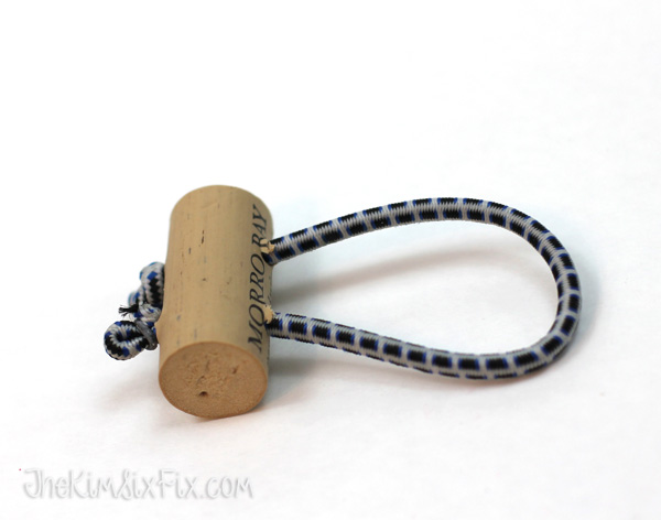 Wine cork bungee tie back