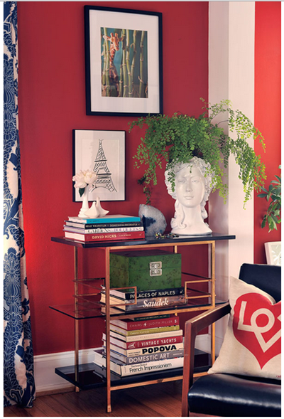 red walls with gold accents by Jamie Meares