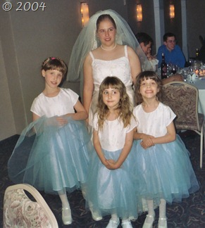 The beautiful bride with her three young cousins