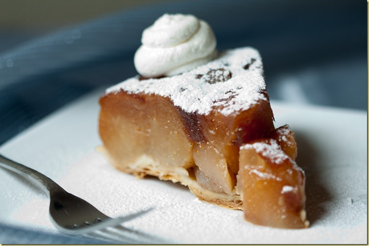 Tarte Tatin - French apple tart with caramelized apples and puff pastry based, all drizzled with caramel on top.