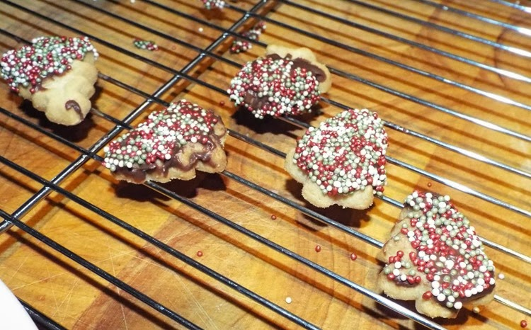 cookies deccorated in chocolate and sprinkles