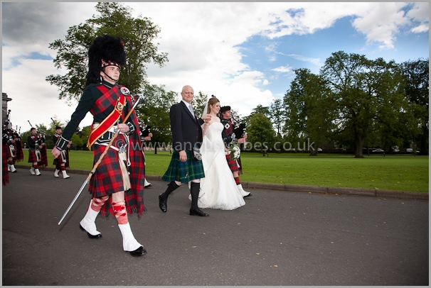 pipe band lead bride and groom to dinner