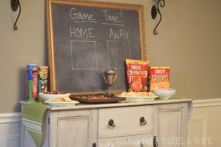Add a vintage theme to your Big Game party with an aged trophy and an oversized chalkboard to keep score. An easy to throw party for the Big Game. Features easy party ideas for snacks, dips and decor. Includes a recipe for Roasted Red Pepper Hummus without seeds! #BigGameSnacks #collectiveBias #ad