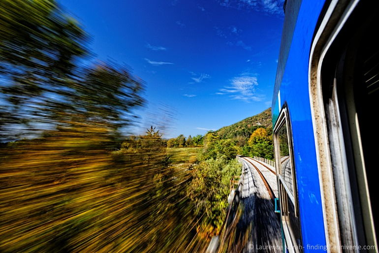 Train rushing through fall colours italy molise scaled
