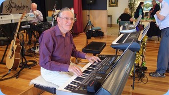 Roy Steen playing the Korg Pa3X. Photo courtesy of Dennis Lyons.