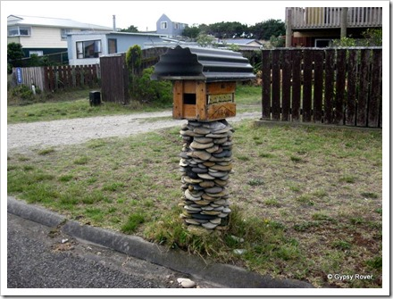 Novel mail boxes at Koitiata, Turakina. Beer crate lined with flattened beer can's.