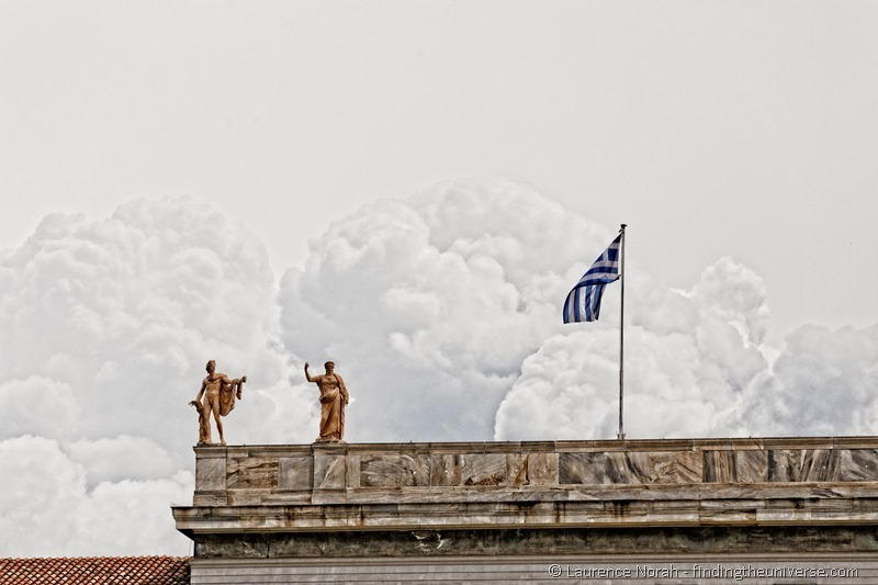 Statues and greek flag athens
